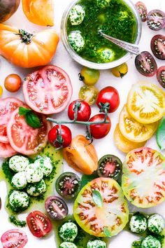 Colorful sliced tomatoes with basil marinated mozzarella