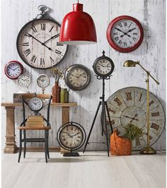 Assortment of clocks from Domayne. Esspecially love the large Red 'Fontaine' clock.