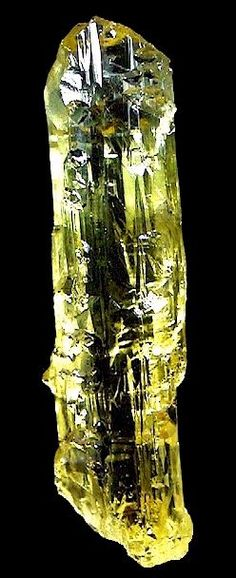 Gemmy and doubly terminated Beryl var. Heliodor crystal! From Mine No.2 in Volodarsk-Volynskiy, Zhitomir Oblast', Ukraine.  Measures 8.5 cm in length by 2.3 cm in width! Glows with color!  From the R. Larkin Collection. Photography by Kevin Ward.  From Exceptional Minerals