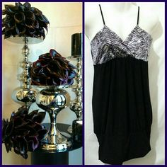 WET SEAL GORGEOUS BLACK PURPLE SILVER DRESS GORGEOUS BLACK DRESS with SEQUINS of PURPLE SILVER. GREAT for VALENTINES DAY!  92% Polyester   6% Spandex            BUNDLES WELCOMED AND ENCOURAGED                USE OFFER BUTTON FOR ANY OFFERS                          NO PAYPAL *NO TRADES       MERCI BEAUCOUP! VALENTINES DAY BOUTIQUE Wet Seal Dresses Mini