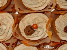 Pumpkin cupcakes filled with pumpkin pudding, topped with cinnamon cream cheese frosting and a candied pecan.