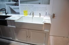 This contemporary take on the traditional farmhouse sink, with horizontal banding across the front, is from Kohlers. Called Whitehaven Hayridge, it retails for $1899.