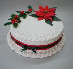 Christmas cake with poinsettia and holy by yud, via Flickr