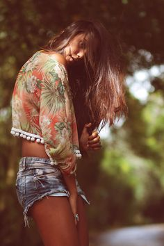 Summer pompom floral blouse and denim cut-offs. Adorable. I'd need a longer version of the blouse though!