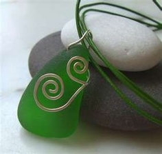 Genuine emerald green sea glass pendant, hammered sterling silver wire wrapped. Pattern inspired by the swirling waves. Matching earrings too! Sold!