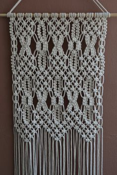 Wall panels handmade macramé technique. Material: 100% cotton. Color: white. Strap: natural wood - pine. Dimensions: The length of the strap to the bottom, including the thread - 140cm / 55.1 inches The width of wall hanging - 42cm / 16.5 inches