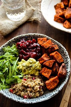 Grab-N-Go Sweet Potato, Cranberry & Quinoa Power Bowl | This vegan, gluten-free power bowl packs a punch of nutrients and satisfying flavors into one bowl!