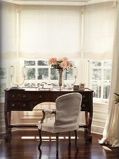 Traditional Chic home office space with a gorgeous bay window & beautiful window coverings!