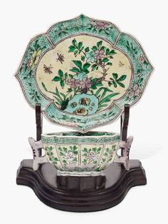 A famille verte biscuit quatrefoil cup and saucer, Kangxi period (1662-1722), cup 3 ⅜ in (8.6 cm) wide, saucer 4 ⅝ in (11.7 cm) wide. Estimate $600-800. This work is offered in Collected in America Chinese Ceramics from The Metropolitan Museum of Art online auction, 13-22 September
