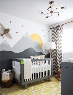 Wall mural combined with the chevron curtains provides an excellent source of visual stimulation for a newborn baby. The slight pop of colour in muted yellow on the mural and floor rug also allows for a great starting point to introduce more colour as baby's sight develops.