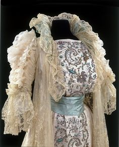 Tea gown, detail: Made in Paris circa 1900 by House of Rouff. Woven silk damask embroidered with glass, metal thread and beads, and embroidered net and lace.