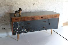 Buffet/sideboard. Black. Multi-coloured squares. Formica.