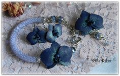 Set with a black orchid made of polymer clay and crystal. Vintage ornaments with orchid.