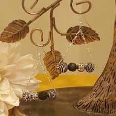 Check out this item in my Etsy shop https://www.etsy.com/listing/449763752/dangling-zebra-and-lava-stone-earrings