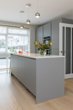 Pearl Grey kitchen island design in handleless kitchen finish.