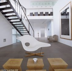 Check out this sculptural seating: The sinuous La Chaise design by Charles and Ray Eames in a slick setting. Charles Eames, Plastic Rocking Chair, Rocking Chairs, Lounge Chairs, Home Furniture, Furniture Design, Plywood Furniture, Chair Design, Design Design
