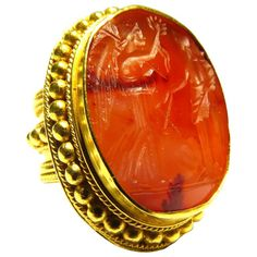 Antique Carnelian Agate Seal with Angel motif in Etruscan Gold Ring. This is a very large exceptional antique seal ring mounted in 21K gold. There is a makers mark as shown in image 6 that I can not make out and on the other side, image # 7, is the 21K mark. The seal stone is a rare carnelian agate. The Etruscan mount has hand placed balls around the bezel and all across the shank. mid 19th century