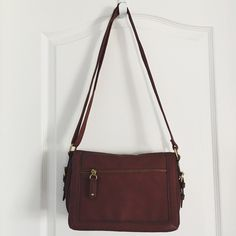 """Merona Cross Body Bag Merona Cross Body Bag  ·         Maroon ·         Faux Leather ·         Brass hardware ·         Adjustable shoulder strap ·         Flap closure with magnetic snap ·         Large pocket on front under flap ·         Zipper pocket on flap ·         Interior zipper pocket ·         2 interior slip pockets ·         ***small scuff mark on front flap (as pictured) ·         Measures 11""""x2.5""""x6.5"""" Merona Bags Crossbody Bags"""