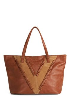 I'm sure I can find a cheaper version of this somewhere, and it isn't that bad, but I keep thinking this would be a great craft project - Wandering Westward Shoulder Bag - modcloth.com