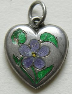 Victorian Enameled Violet Sterling Heart Charm  This  very hard to find Victorian sterling heart charm features an enameled violet, the flower for the month of March.