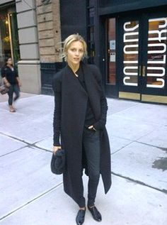 Anja Rubik - I'm wearing Chanel shoes, a Rick Owens coat, Topshop jeans and a Helmut Lang sweater. l was in a rush so decided with all black - you can never go wrong with that.