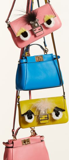 Make your handbags indistinguishably yours with some personalized trinkets or adding a #Fendi monster mini #SaksStyle