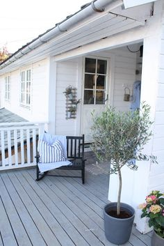 Wooden deck on traditional house in Norway. Can pull double rocker back under overhand or pull out onto open space.