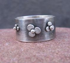 Wildflower Wide Band . sterling silver ring with freeform flowers . rustic oxidized-brushed finish . made to order in your size. $76.00, via Etsy.