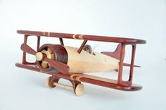 Handcrafted wooden toy plane with Padauk and Maple.   Made by Nicholas McCarron