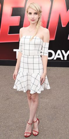 Emma Roberts in a windowpane-print dress with Stuart Weitzman sandals.