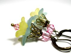 Spring Flower Earrings from jewelry by NaLa https://www.etsy.com/listing/97501020/pink-yellow-blue-vintage-style-flower #Spring #fashion #style #gifts #products #yellow #pink #blue #jewelry #earrings
