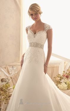 Combine classic and modern with elegance in Bridal by Mori Lee 2616. This alluring wedding gown elaborates a strapless and sweetheart neckline. Waist is covered with a thick beaded band that slims and flatters your shape. The flared skirt is fully coated with Alencon Lace and Net. Removable coverlet included. This style can also be ordered in 55 inches or 58 inches lengths, subject to availability.