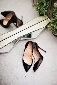 Black Louboutin Pumps