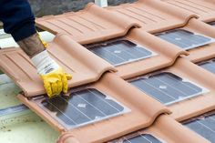 Roof with solar panel tiles