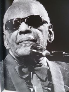 """Ray Charles, performing (prob. in Antibes at Jazz à Juan, in 1999 or 2001). Photo by Albert Saladini. From: """"Gueules de Jazz"""", a book compiled for the 2003 edition of the festival."""