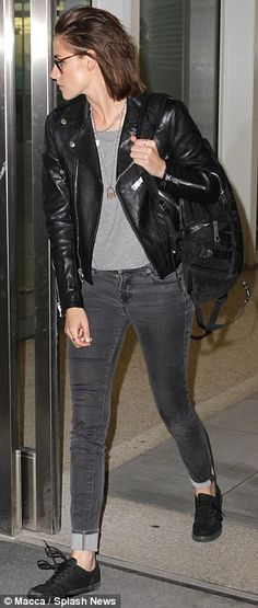 Effortlessly chic: The actress stunned in a black designer dress with a second transparent skirt and bandage bodice at the Equals premiere and then changed into jeans and a jacket with black plimsolls for her flight
