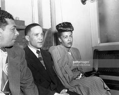 Jazz singer Billie Holiday (R) is read the charge for heroin possession at the U.S. Commissioners Office, seated next to her are her pianist Bobby Tucker (C) and road manager James Asendio (R) on May, 20, 1947 in Philadelphia, Pennsylvania.
