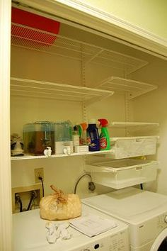 laundry nook with Elfa shelving & slimline fridge jugs to hold detergent & softner. The Container Store.