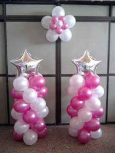columnas de globos con estrellas