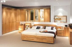 Cool Inspire Bedroom For Man with Rustic Wooden Cabinet Set using Mirrors Near Cream Wooden Couch Bed and Wooden Headboard Bed and White Black Cushions Near Wood Nightstand Cabinetry also White Wall Paint Color and Wall Mounted Mirror also Hidden Ceiling Lights Idea