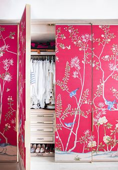 Dramatic red chinoiserie wall paper disguises a large clothes closet. Photographer Brittany Ambridge for Domino Magazine on decor8