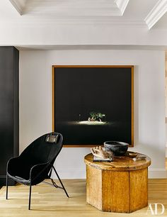 A photograph by Oswaldo Ruiz is displayed next to a midcentury Italian chair and a vintage Mexican drum table in the family room.