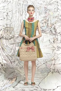 Red Valentino's bag and floral necklace for Spring 2013.