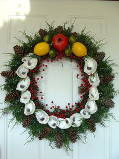 Williamsburg styled wreath with real Chesapeake Bay Oyster shells and accented with artificial Fruit, Berries and Juniper.Very classy decor