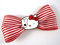 "Poor Hello Kitty - she's beginning to decompose!    Set on a 3"" bow made of satin striped red and white ribbon on an alligator clip for a spook-tacular hair piece!"