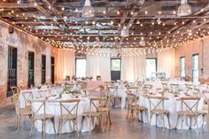 Dye house // cafe lights // place setting // crossback chairs // classic // elegant // all white // florals
