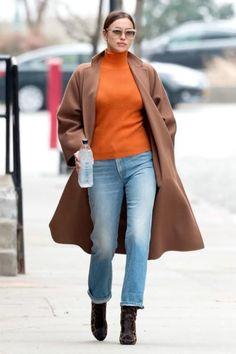 Irina Shayk wearing Max Mara Saio Coat, Frame Voluminous Sweater in Vibrant Orange, Celine 41023 Traveller Sunglasses, Miu Miu Pre-Fall 2016 Dahlia Bag and Frame Denim Rigid Re-Release Jeans in the Echo