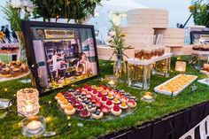 Love the green grass table cover for this dessert table! A Vibrant Singapore Wedding at Marina Barrage: Veiverne and Debbie