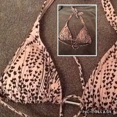 👙Sexy Victoria's Secret VS bikini top,pink, Small Victoria's Secret bikini swim top, pink/mauve, with black flowery design and silver middle part. Sexy and comfortable! Wear with any bottom you like! Size Small. Lightly padded, pads are also removable. Perfect for summer!  Bundle with other items to get a great discount! Victoria's Secret Swim Bikinis