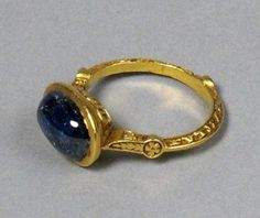 "A 14th century gold and sapphire ring. An inscription along the inside reads something along the lines of ""Rufus of York, singer of the Episcopal City."" From Once and Future Thing. via Melissa E"